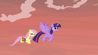 Twilight and Fluttershy flying through the sky S7E20