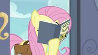 Fluttershy reading a Daring Do book S9E21