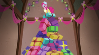 Spirit of HW Presents standing on top of gift pile S6E8