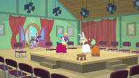 Twilight and Spike enter theatre hall S9E5