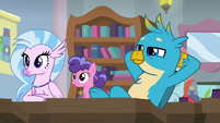 Gallus leaning back in his chair S8E21