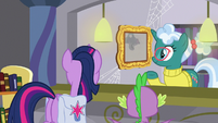 Librarian looking at Twilight's wall photo S9E5
