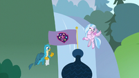 Silverstream and Gallus waving to ponies below S8E2