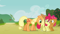 Applejack pushing Apple Bloom and Babs S3E08