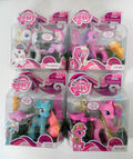 Blossomforth, Cupcake, Dewdrop Dazzle and Lulu Luck toys.jpg