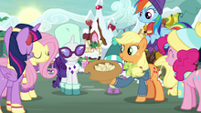 Mane Six gathered around the hat MLPBGE.png