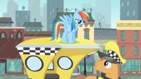 Rainbow Dash on top of a cab S4E08