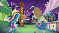 Rainbow and Applejack running to carnival games EG2