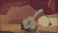Biff using a pickaxe on a rock S9E21