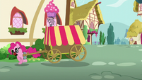 Pinkie Pie moves out from behind the house S5E19