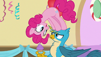 Pinkie Pie standing on Gallus' head S8E12