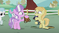 Diamond Tiara shows Noi a bookbag S5E18
