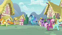 Ponies flee from Princess Ember in terror S7E15