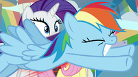 Rainbow swoops past Rarity and Fluttershy S9E7