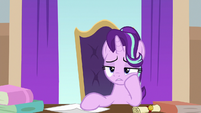 Starlight sits uncertain at Twilight's desk S8E15