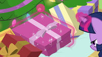 Twilight Sparkle picking up a gift box BGES2