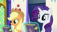 Journal copies float in front of AJ and Rarity S7E14