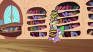 Spike and a tower of books