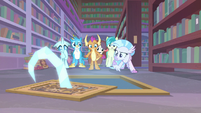 Young Six in front of open floor grate S8E22