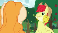 Bright Mac holding a bouquet of buttercups S7E13