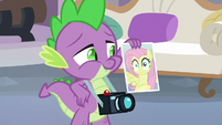 Spike holding Fluttershy's photograph S8E9