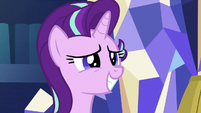 Starlight Glimmer gives a grin of forced interest S7E24