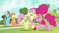 Fluttershy and Pinkie bump heads together S6E18