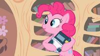 Pinkie Pie rocking a book S2E13