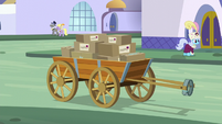 A carriage with boxes S5E15