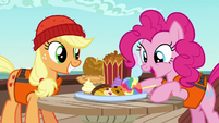 Applejack and Pinkie marveling at snacks S6E22
