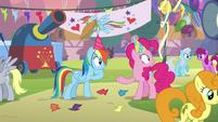 Rainbow Dash knocks pie out of Pinkie's hoof S7E23