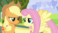 Fluttershy holds back pouting Applejack S03E10