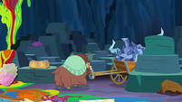 Yona pulls wagon out from behind rock S9E3
