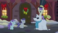 Princess Erroria grabs the hat of a snowpony S06E08