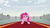 Pinkie Pie standing on the large red carpet S9E14