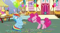 Rainbow Dash tying balloons to the pie S7E23