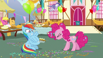 Rainbow Dash tying balloons to the pie S7E23