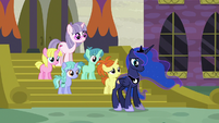 Princess Luna standing in front of unicorn filly S7E10