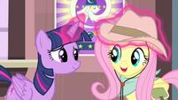 Twilight adjusting Fluttershy's hat S4E11