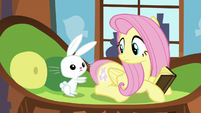 Angel pointing at Fluttershy's cutie mark S5E23