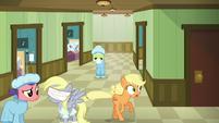 Applejack frantically runs up and down the hallway S6E23