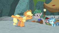 Applejack stretching her hooves S7E25