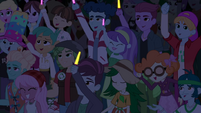 Festival-goers cheering and holding glowsticks EGSBP
