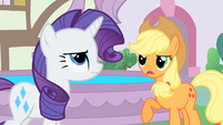 Applejack and Rarity next to the fountain S1E22