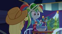 Rainbow uncapping a cream bottle CYOE15a