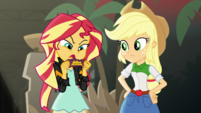 Sunset Shimmer reads the candy wrapper label EGS2