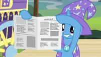 Trixie revealing a reassembled newspaper S7E24