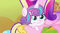 Flurry Heart cradled in Princess Cadance's hooves S7E22