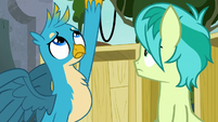Gallus holds cupcake over the barricade S8E2
