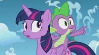 Spike pointing toward filly Rainbow S5E25